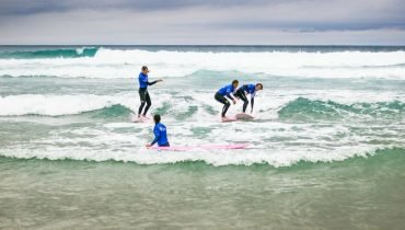 Learning how to surf at our French surf camps
